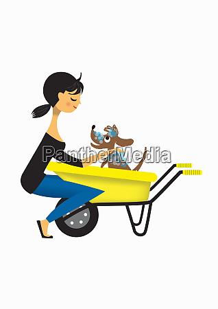 woman washing dog in wheelbarrow