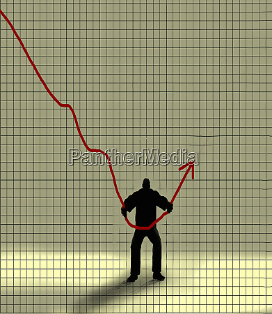 strong businessman turning graph around from