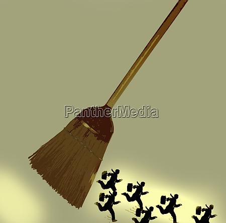 businessmen running away from sweeping broom