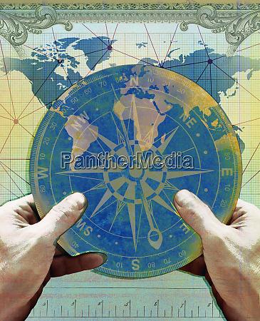hands holding navigation compass over chart