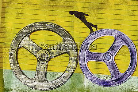businessman balancing on finance cog wheels