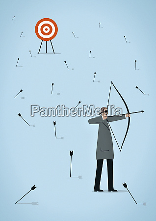 blindfolded businessman with bow and arrow