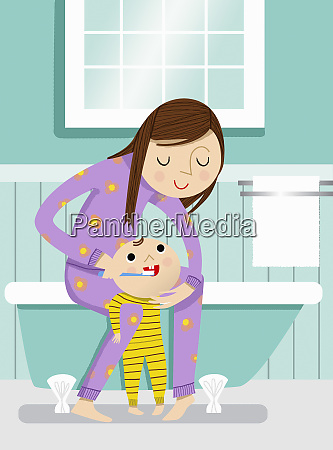 mother helping baby brush teeth in