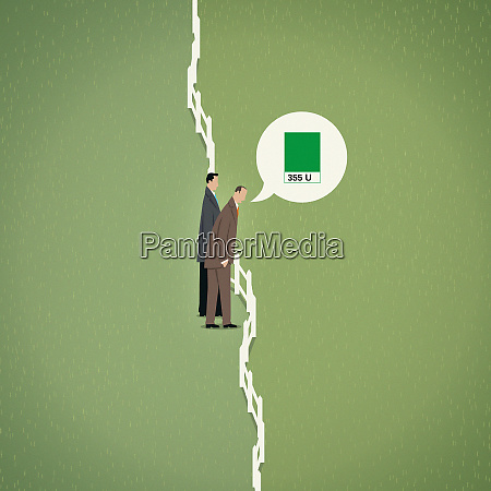 businessmen assessing green color of grass