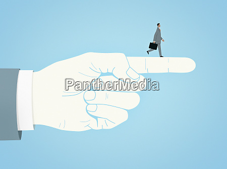 businessman walking on pointing finger