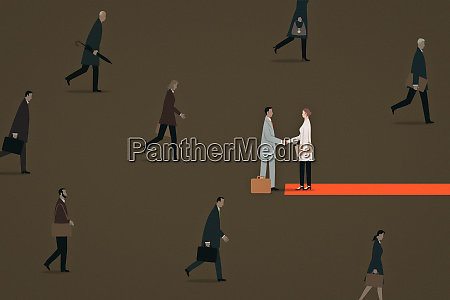 businesswoman greeting businessman on red carpet