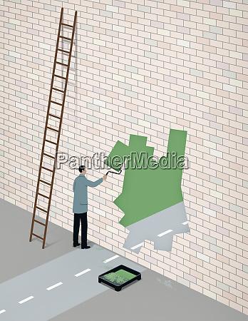 businessman painting road opening through brick