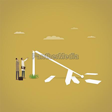 businessman and businesswoman lost beside broken