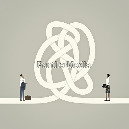 businessman and businesswoman separated by tangled