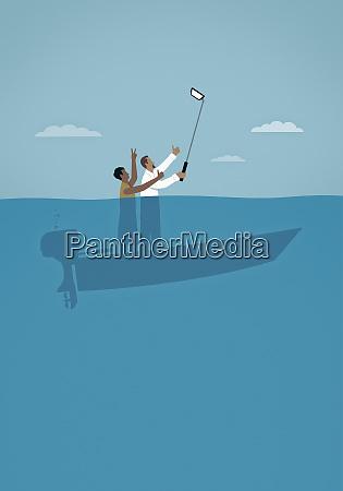 couple taking selfie on sinking boat