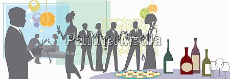 men and women socializing at formal