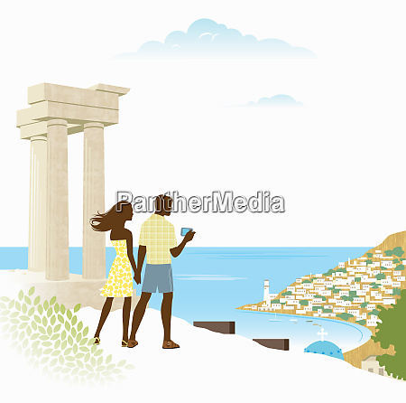 couple taking photograph of scenic view