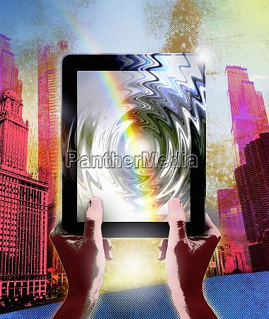 rainbow over rippling digital tablet in