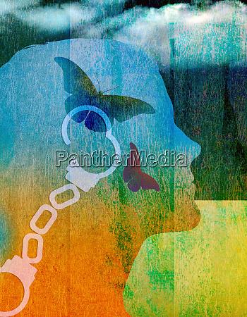 open handcuffs and butterflies inside of