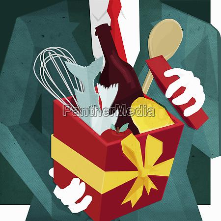 businessman opening odd gift