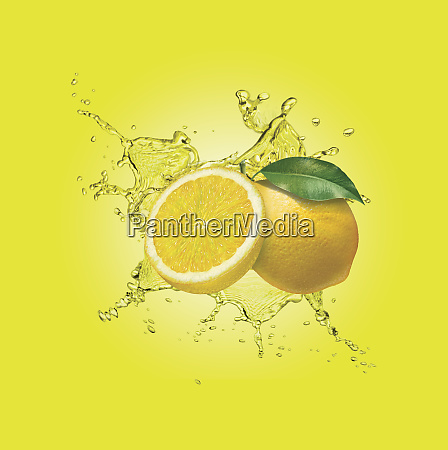 water splashing around lemons