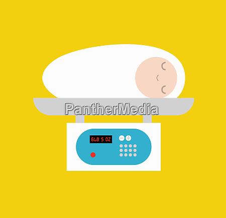 newborn baby on weight scale