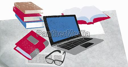 books laptop and eyeglasses