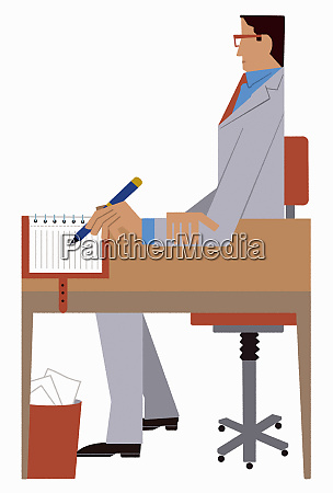 businessman writing in notebook sitting at