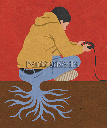 teenage boy playing with games console
