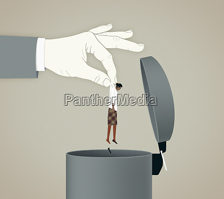 large hand throwing businesswoman into bin