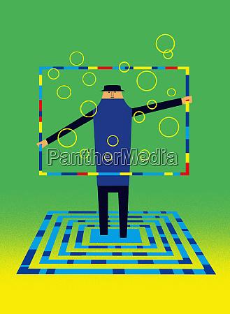 man standing on geometric design holding