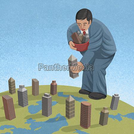 businessman placing office blocks around the