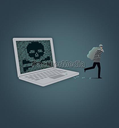 burglar stealing data from laptop computer