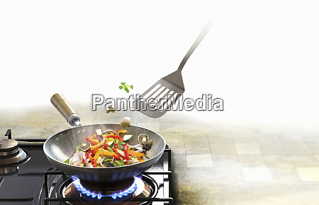 spatula stirring stir fry vegetables in