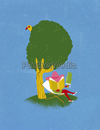 woman reading under tree eating large