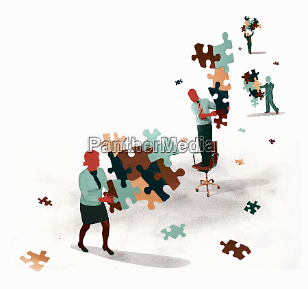 business people holding separate disconnected jigsaw