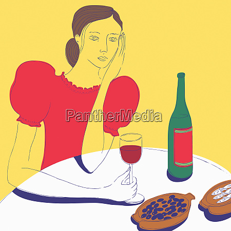 woman drinking red wine eating tapas