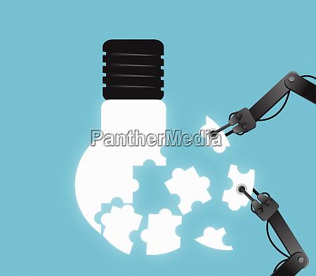 robot arms assembling jigsaw pieces into