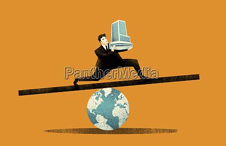 businessman balancing office building on globe