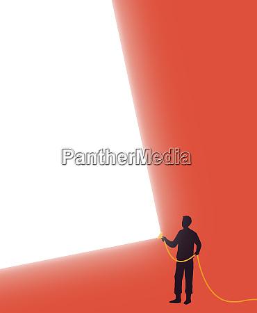 man shining bright beam of light