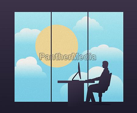 businessman sitting at desk in modern