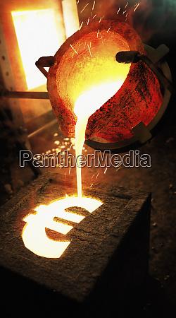 molten metal pouring into euro sign