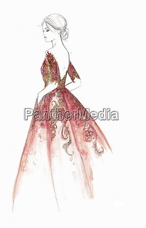 elegant woman wearing backless ornate evening
