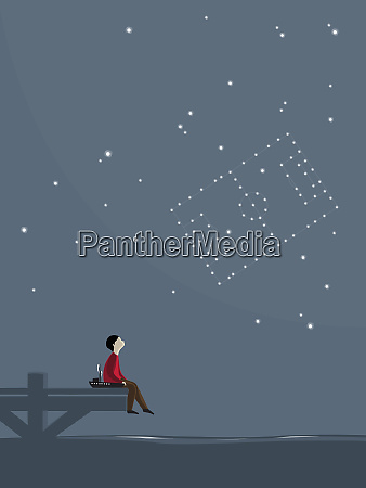 boy sitting on jetty and watching