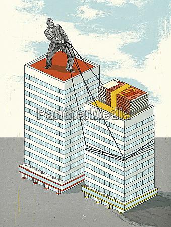 businessman standing on skyscraper pulling building