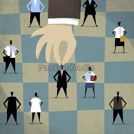 large hand choosing businessman standing out