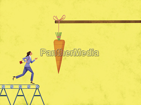 carrot dangling in front of businesswoman