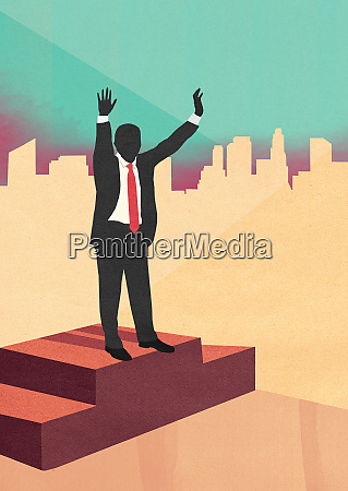 businessman celebrating victory with arms raised