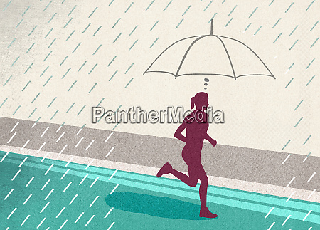 focused woman protected from rain by