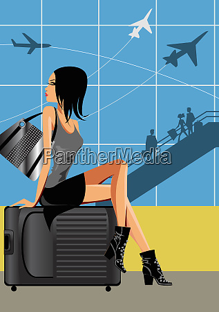 beautiful woman sitting on baggage at