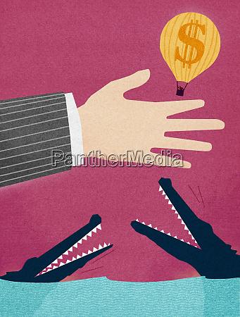 businessman releasing dollar hot air balloon
