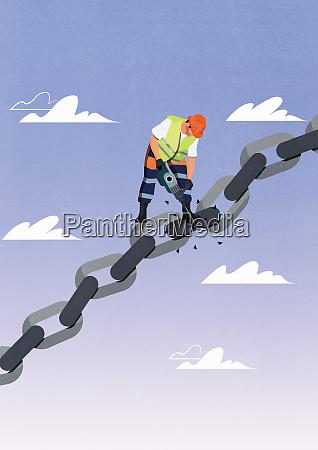construction worker breaking a link in