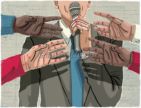 hands reaching for microphone held by