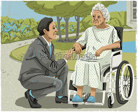 man in suit talking to elderly