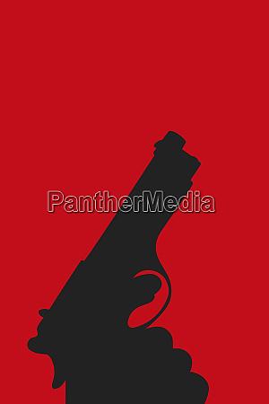 silhouette of hand holding gun